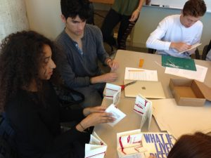 students sewing handmade books